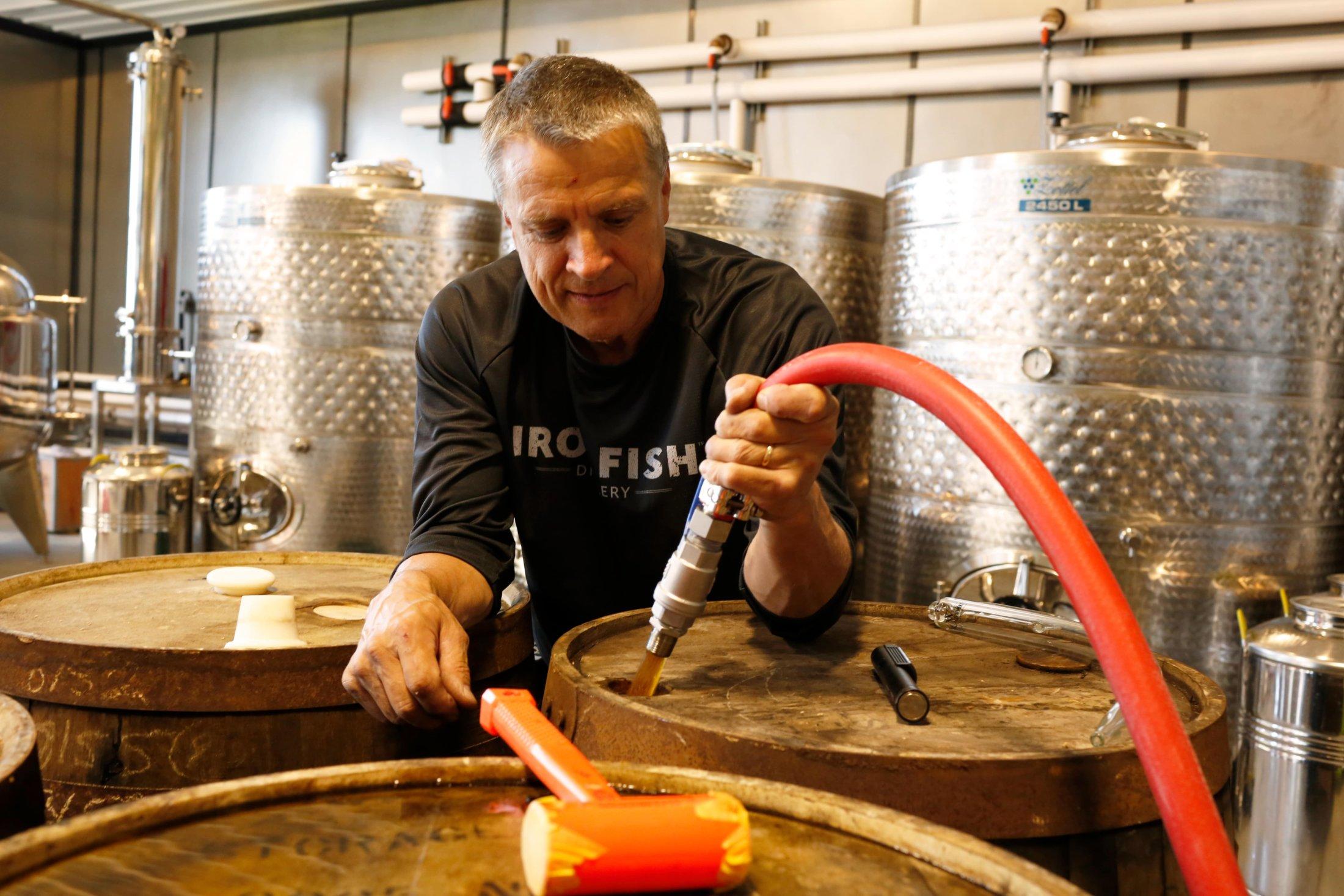 Owner David Wallace Filling Barrels-min